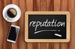 Coffee, phone and chalkboard with reputation  word.  Stock Images