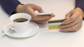 Coffee, phone, and credit card Stock Photo