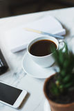 Coffee, phone and empty notepad Royalty Free Stock Photo