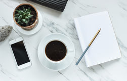 Coffee, phone and empty notepad Royalty Free Stock Image