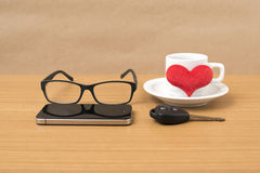 Coffee,phone,eyeglasses and car key. On wood table background Stock Image