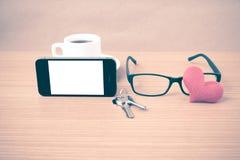 Coffee,phone,eyeglasses,key and heart Stock Photography