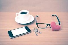 Coffee,phone,eyeglasses,key and heart Royalty Free Stock Photo