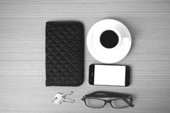 Coffee,phone,key,eyeglasses and wallet Stock Photos
