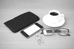 Coffee,phone,key,eyeglasses and wallet Stock Images