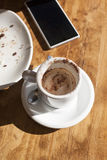 Coffee and phone Stock Photography