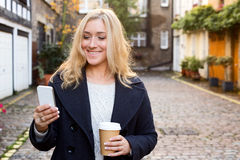 Coffee and phone Royalty Free Stock Photos