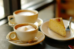 Coffee and pie. Cappuccinos and pie Stock Images