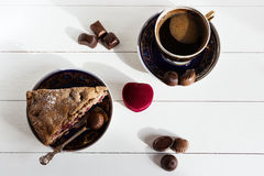 Coffee, pie and box with ring on white background.  An offer of marriage, box which give ring. Coffee, pie, chocolate candies and box with a ring on a white Stock Photography