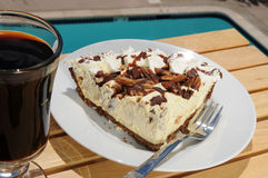 Coffee and pie served by the pool Royalty Free Stock Photo