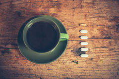 Coffee and pills Stock Photos