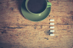 Coffee and pills Royalty Free Stock Images