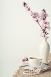 Coffee and pink cherry blossoms stock photos