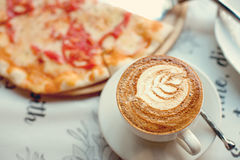 Coffee and pizza Margarita On a paper napkin royalty free stock images
