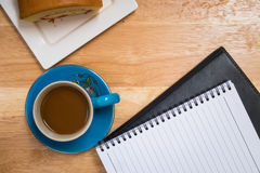 Coffee placed on a wooden floor Stock Photo