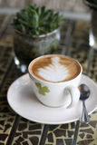 Coffee and plant. On table Royalty Free Stock Images