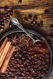 Coffee on Plate. Coffee Beans and Ground Coffee with Spices on Plate royalty free stock image