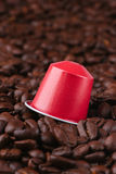 Coffee pod on roasted beans Stock Images