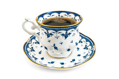 Coffee in a porcelain cup with a blue pattern Stock Image