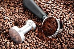 Coffee portafilter. On coffee bean background Royalty Free Stock Photo