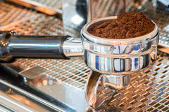 Coffee portafilter filled with finely grounded coffee Stock Photos