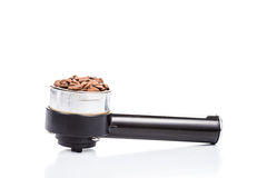 Coffee portafilter or handle filled with coffee beans in white background Stock Photography