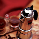 Coffee pot. Espresso pot and cup of coffee Stock Image