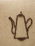 Coffee-pot. Drawing of coffee-pot by coffee seed on the sackcloth Stock Image