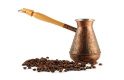 Coffee pot. And coffee beans isolated on white background Royalty Free Stock Photography
