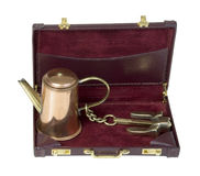 Coffee Pot with Anchor in Briefcase Stock Photo