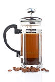 A coffee pot with beans Stock Images