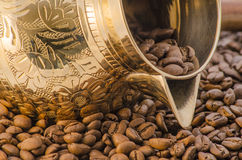 Coffee pot. Brass coffee pot and coffee beans Royalty Free Stock Photography