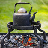 Coffee Pot on the Campfire Royalty Free Stock Image