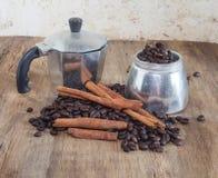 Coffee pot and coffee bean Stock Photos
