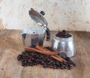 Coffee pot and coffee bean Stock Image