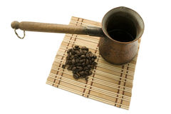 Coffee pot with coffee beans Stock Images