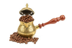 Coffee pot and coffee beans Stock Images