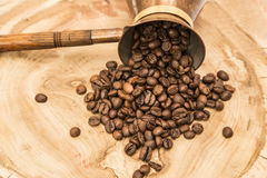 Coffee pot with coffee beans. On a wooden background Stock Photos