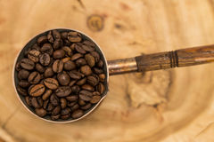 Coffee pot with coffee beans. On a wooden background Stock Photography