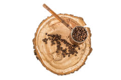 Coffee pot with coffee beans on a wooden background Stock Photo