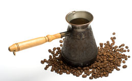 Coffee-pot and coffee grains. Royalty Free Stock Photo