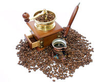 Coffee pot and Coffee-grinder. Turkish Coffee pot, Coffee-grinder and coffee grains Royalty Free Stock Photo