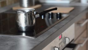 Coffee pot on cooking plate with boiling water in. Royalty Free Stock Photos