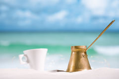 Coffee pot and cup on beach Royalty Free Stock Images