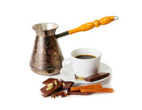 Coffee pot, cup of coffee with spices and chocolate isolated Royalty Free Stock Photography