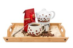 Coffee pot with cup, red bag on wooden tray Stock Photography
