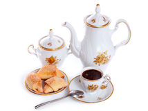 Coffee pot with cup and saucer of cakes Royalty Free Stock Photo