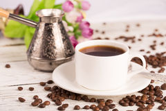 Coffee pot, cup and scattered coffee Stock Photography