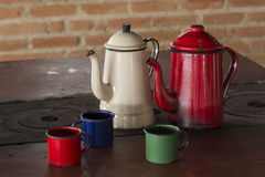 Coffee pot and cups in the wood stove Royalty Free Stock Images