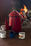 Coffee pot and cups in the wood stove Royalty Free Stock Photo